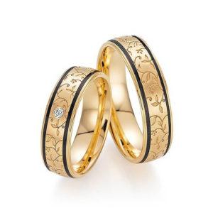 Goldene Ringe mit schwarzen Streifen und floralem Muster